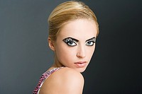 Woman with zebra stripe eye makeup
