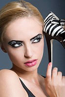 Woman with zebra stripe makeup and shoe