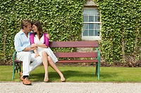 Happy couple on bench (thumbnail)