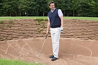 Male golfer in the bunker