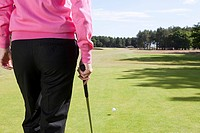 Rear view of a female golfer