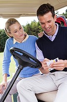 Golfing couple in a golf cart