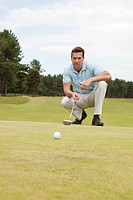 Male golfer putting