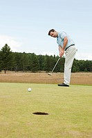 Male golfer on the putting green