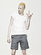 Young albino man dancing