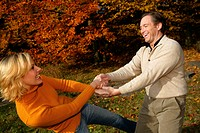 couple having fun in autumn