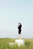 business woman standing on box on reed beds