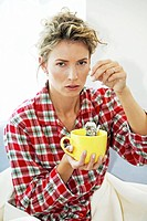 woman having a cold drinking tea