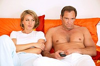 couple watching tv in bed tv evening