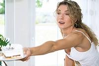 woman handing a plate