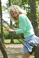 young blonde woman swinging