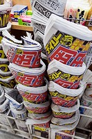 Typical neat stack of Japanese newspapers outside newsagent shop in Tokyo