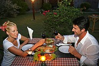 couple in love enjoying seafood at restaurant in yao yao island resort Thailand