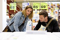 Couple shopping for household appliance