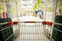 Entering supermarket with shopping cart
