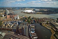 View of London skyline looking towards Poplar Wharf and Marina, O2 Arena and Thames Barrier, Canary Wharf, London, England, UK