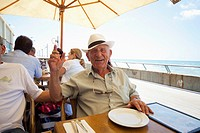 Man enjoying his day having lunch in Tel Aviv Israel with son and friends