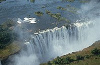 Small aeroplane flying over Victoria Falls, Zimbabwe