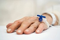 Patient´s hand with IV drip, close_up