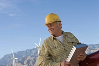 Senior man working at wind farm