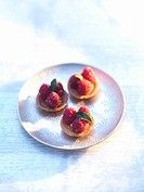 Three small raspberry tartlets