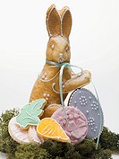 Baked Easter Bunny and biscuits on moss