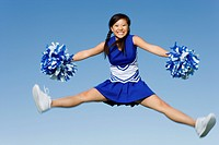 Smiling Cheerleader jumping in mid_air portrait