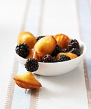 Madeleines with blackberries on cocktail sticks