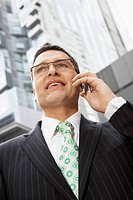 Businessman using mobile phone portrait
