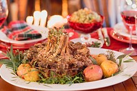 Crown roast of lamb with apples on Christmas table USA