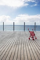 Baby stroller on wooden Dock