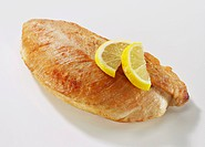 Roast turkey breast fillet with lemon slices