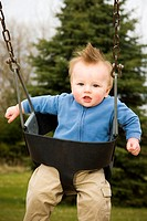 Happy Boy on Swing