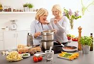 Women tasting the tomato sauce