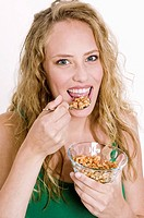Woman eating crunchy muesli