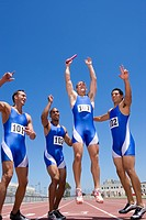 Young male runners cheering after winning race (thumbnail)