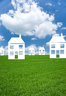 Cut out houses in grass field