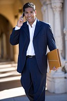 Businessman talking on cell phone outdoors