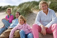 Portrait of family relaxing on beach (thumbnail)