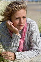 Close_up of young woman lying on beach