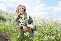 Portrait of young woman in grass