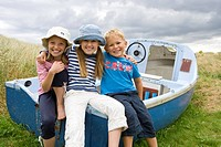 Portrait of children sitting on boat