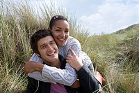 Portrait of mixed race couple in grass