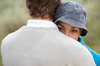 Young couple hugging outdoors, close_up
