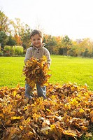 Artist´s Choice: Young boy playing with leaves, Stayner, Ontario