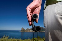 Close up of man holding binoculars