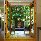View of garden patio and sun fountain, through open french doors, Victoria, British Columbia
