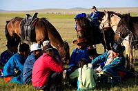 Mongolian family sitting together, Xilamuren Grassland, Da´erhanmaoming´anlianhe Banner, Baotou City, Inner Mongolia Autonomous Region, China
