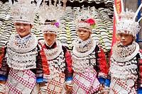 Miao young women wearing elaborate silver ornaments, Zhaoxing Miao Village, Liping County, Qiandongnan Miao and Dong Autonomous Prefecture, Guizhou Pr...
