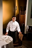 Portrait of Cuban chef standing in fine dining restaurant